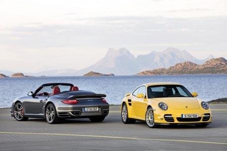 Dos porsche's 911 turbo, en amarillo y gris
