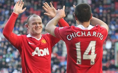 Wayne Rooney y Javier Hernandez